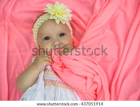 Adorable beautiful newborn baby girl. Maternity and newborn concept. Newborn baby is looking in the camera - stock photo