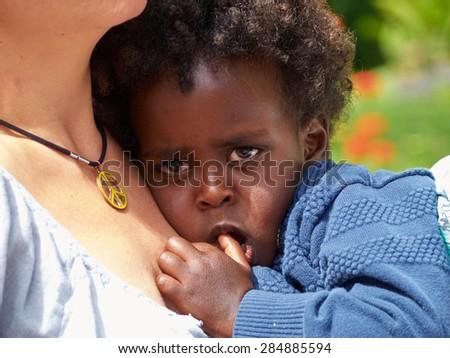 Adorable black sad baby crying with bad mood - stock photo