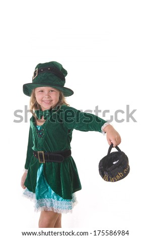 Adorable blond girl smiling dressed up in the studio for St. Patrick's Day  - stock photo