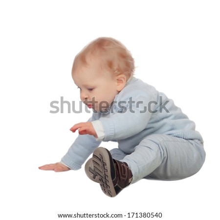 Adorable blonde baby sit on the floor isolated on a white background
