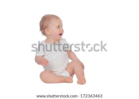 Adorable blonde baby sitting on the floor isolated on a white background