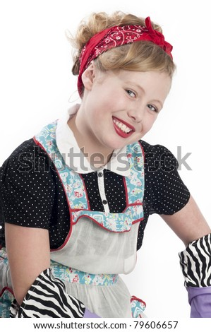 Adorable blonde child model wearing retro apron and head scarf