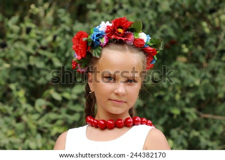 adorable blonde girl dressed in national Ukrainian costume  - stock photo