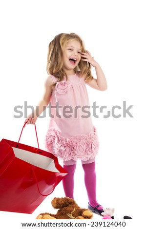 Adorable blonde little girl with pink dress holding an empty shopping bag isolated over white background - stock photo