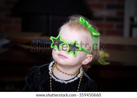 Adorable blonde little girl with the funny glasses - stock photo