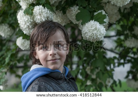adorable boy and flower
