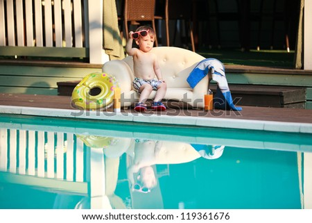 Adorable boy at the swimming pool