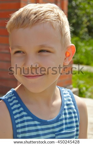 Adorable boy portrait in the summer park - stock photo