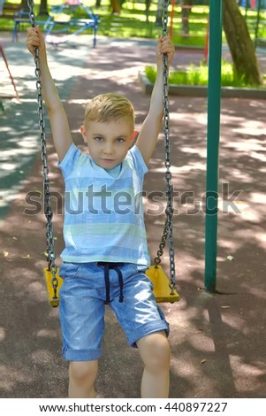 Adorable boy portrait in the summer playground