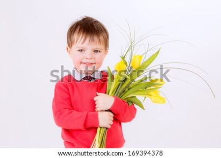 adorable boy with a bouquet of tulips. Spring, March 8, smile, International Women's Day. - stock photo