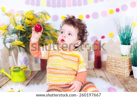 Adorable boy with easter egg in the hands