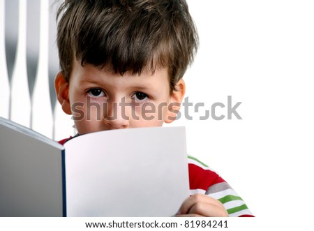Adorable boy with exercise book a over white background