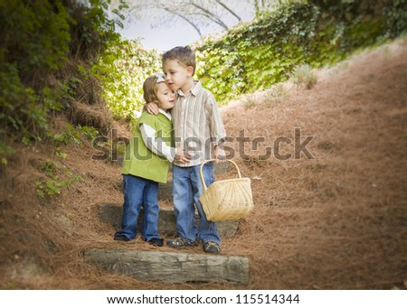 Adorable Brother and Sister Children with Basket Hugging Outside. - stock photo