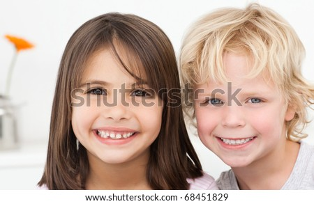 Adorable brother and sister posing in the kitchen at home - stock photo