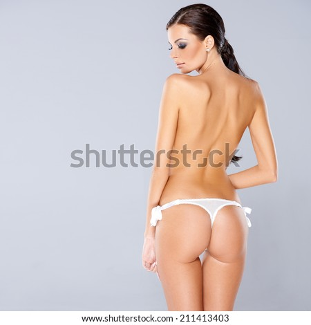 Adorable brunette girl posing isolated with copy space