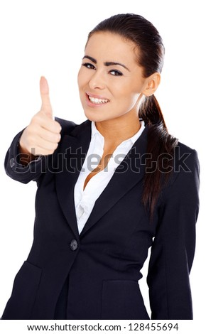 Adorable business woman showing thumb up gesture