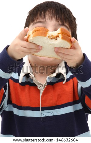 adorable Caucasian Boy Child Eating Peanut Butter Sandwich in Studio - stock photo
