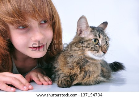adorable child and cat looking at something with surprise - stock photo