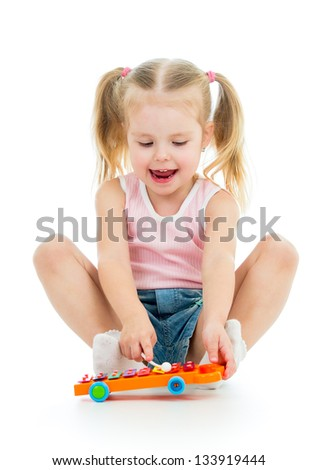 adorable child girl playing with musical toy