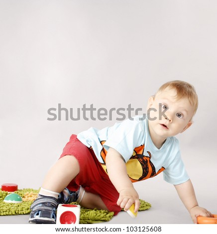 Adorable child playing with different toys - stock photo