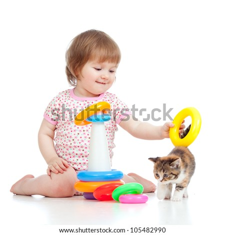 adorable child playing with kitten - stock photo