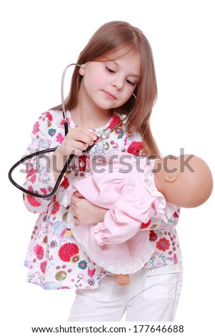 Adorable child playing with toy doll over white - stock photo