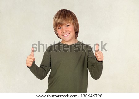 Adorable child saying OK on a over brown background - stock photo