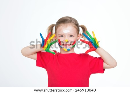 adorable child showing her chef d oeuvre on her palms - stock photo