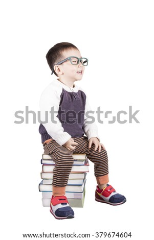 Adorable child studying with books and apple in the head a over white background. - stock photo