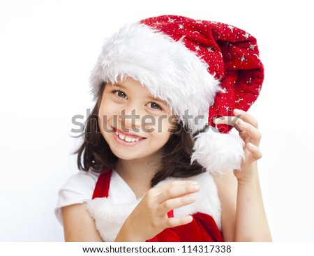 Adorable child wearing santa claus christmas hat - stock photo