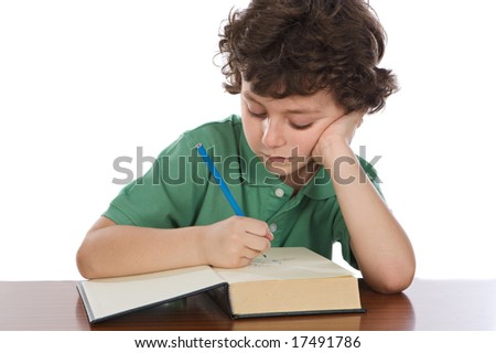 Adorable child write in book a over white background