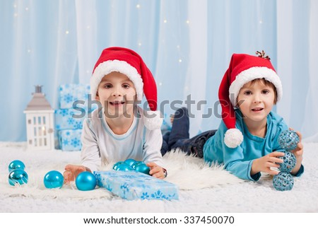 Adorable children, boy brothers, playing with christmas decoration. Christmas concept - stock photo