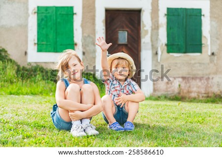 Adorable children resting in a countryside - stock photo