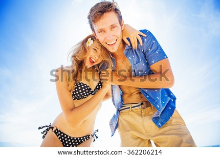 adorable couple in summer on a beach - stock photo