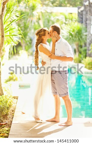 adorable couple in sunlight on their wedding day (sort focus) - stock photo