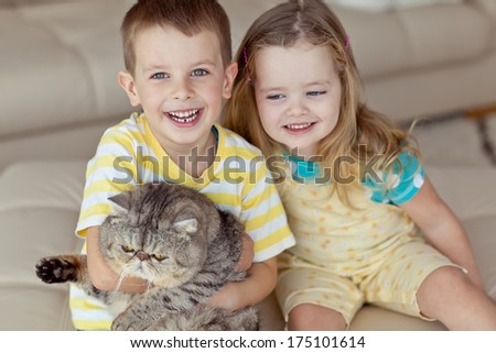 adorable cute baby child playing with kitten - stock photo