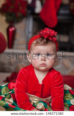 Adorable Cute Infant Baby in Christmas Costume in front of fireplace