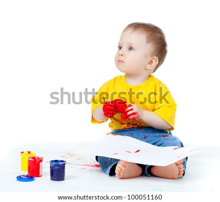 Adorable dirty child with paints - stock photo