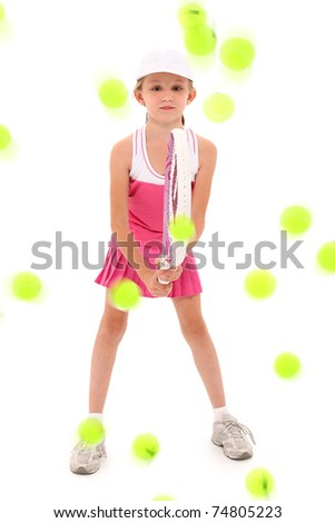 Adorable eight year old girl tennis player being pelted with tennis balls over white background - stock photo