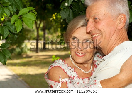 Adorable elderly couple went for a walk in the park