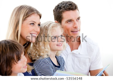 Adorable family watching television together at home - stock photo