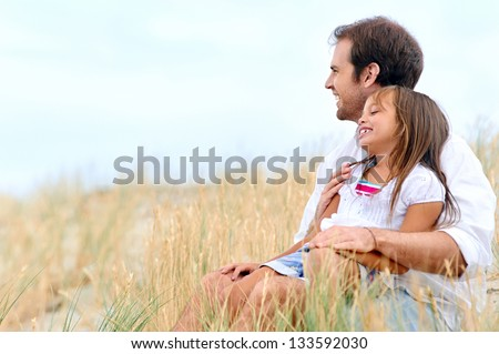 adorable father and daughter have fun together happy healthy lifestyle smiles - stock photo