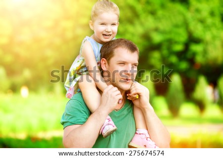 Adorable father and daughter having fun together walk in the park happy smile healthy lifestyle. - stock photo