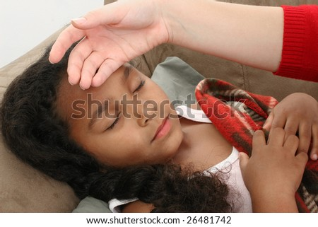 Adorable five year old African American Girl in bed sick. - stock photo