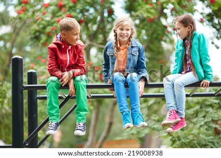 Adorable friends talking at leisure outdoors - stock photo