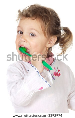 adorable girl cleaning the teeth a over white background