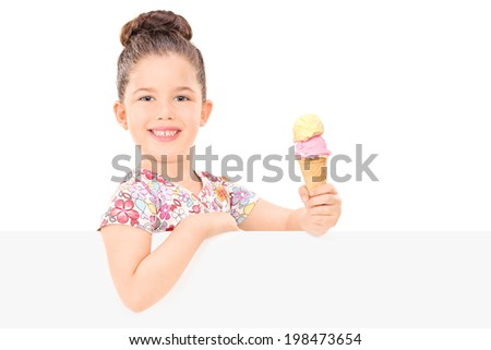 Adorable girl holding ice cream behind a panel isolated on white background - stock photo