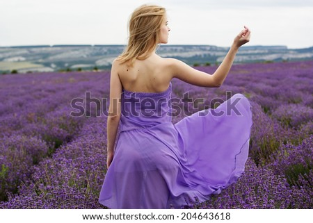 Adorable girl in fairy field of lavender - stock photo