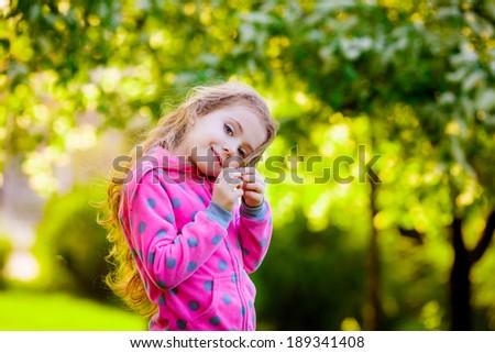 Adorable girl in the garden  - stock photo