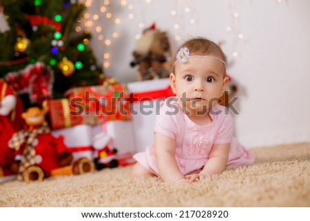 Adorable girl near the Christmas tree. new year. - stock photo